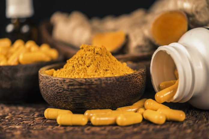 Curcumin Herbal Supplement Capsules and Turmeric Powder