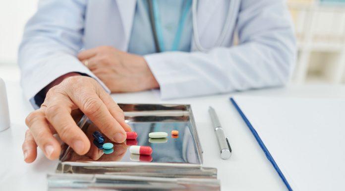 General practitioner taking pil
