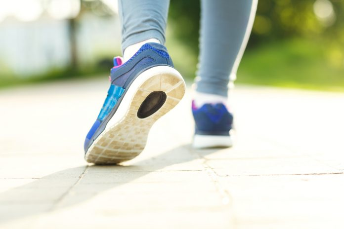 Closeup of female sport fitness runner getting ready for jogging